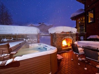 Hot Tub And Fireplace In Snow Outdoor Fireplace Patio