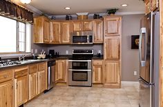 kitchen ideas hickory cabinets, oak floors, stainless steel