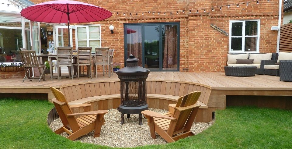 Ipe hardwood with curved sunken seating front room for Garden decking north london