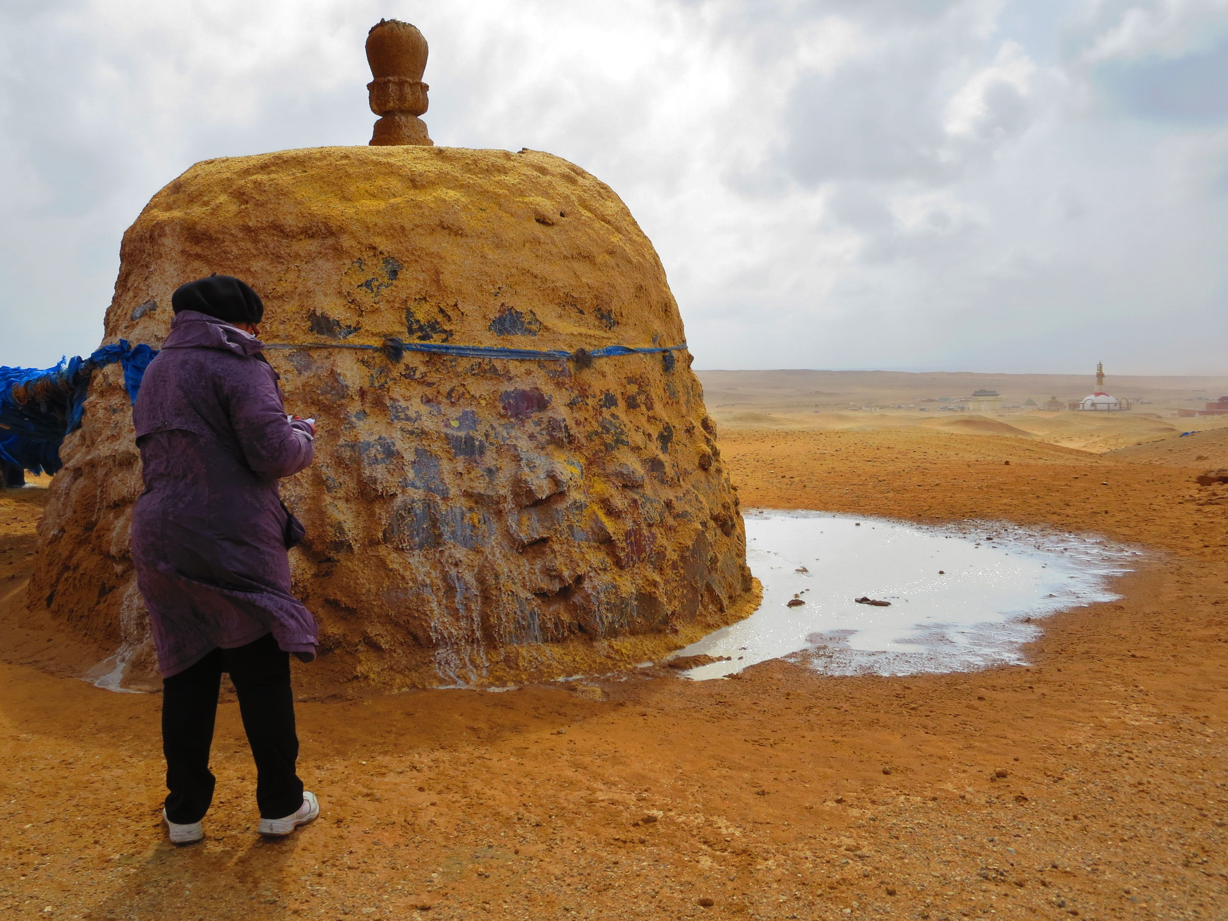 a mongolian shrine or oovoo to carry prayers for fertility milk