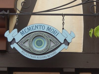 On the 43rd anniversary of Walt Disney World's Magic Kingdom, very quietly, the doors creaked open to the first shop that exclusively carries Haunted Mansion merchandise since the park opened, Memento Mori.