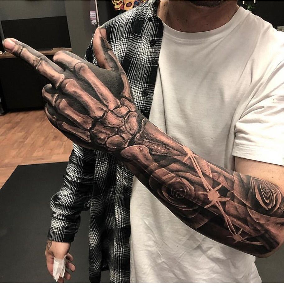 Tattoo By Braddoulttattooartist Bone Flower Rose Hand Tattoo Tattoo Abraddoulttattooa In 2020 Tattoo Sleeve Men Badass Sleeve Tattoos Best Sleeve Tattoos
