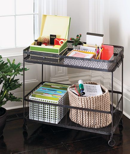 Paperwork and office supplies on a rolling wire cart