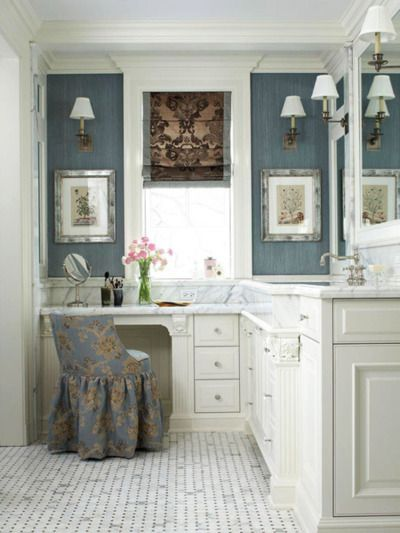 Blue-grey walls, heavy mouldings, classic sconces, marble floor and