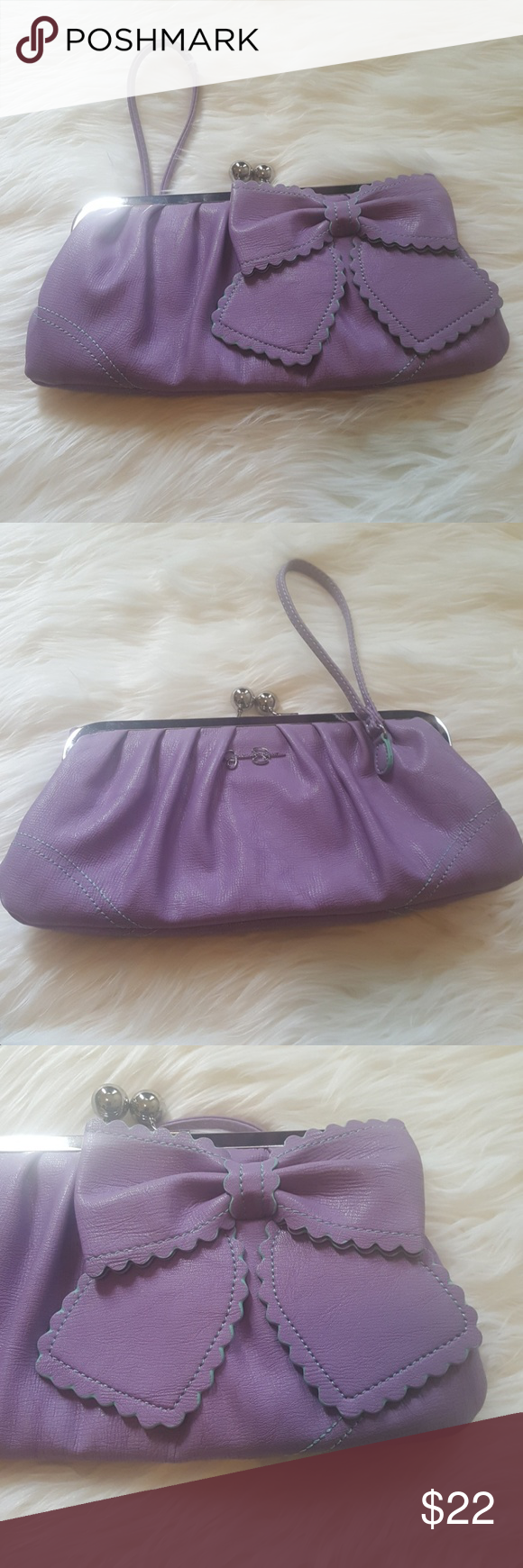 JS Clutch/Wristlet Cute JS clutch with a bow on the front. Jessica Simpson Bags Clutches & Wristlets