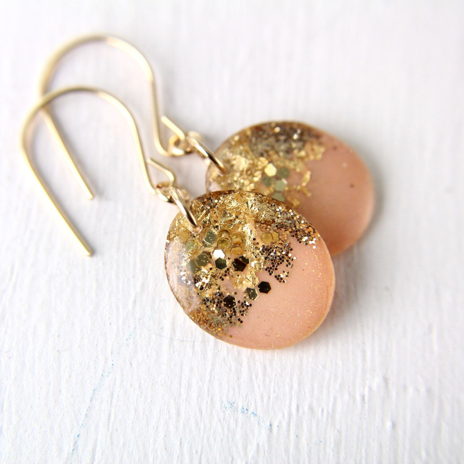 A personal favorite from my Etsy shop https://www.etsy.com/listing/225230438/peach-and-gold-drop-earrings-glitter