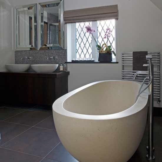 Like the twin basin area, bath and tiles.