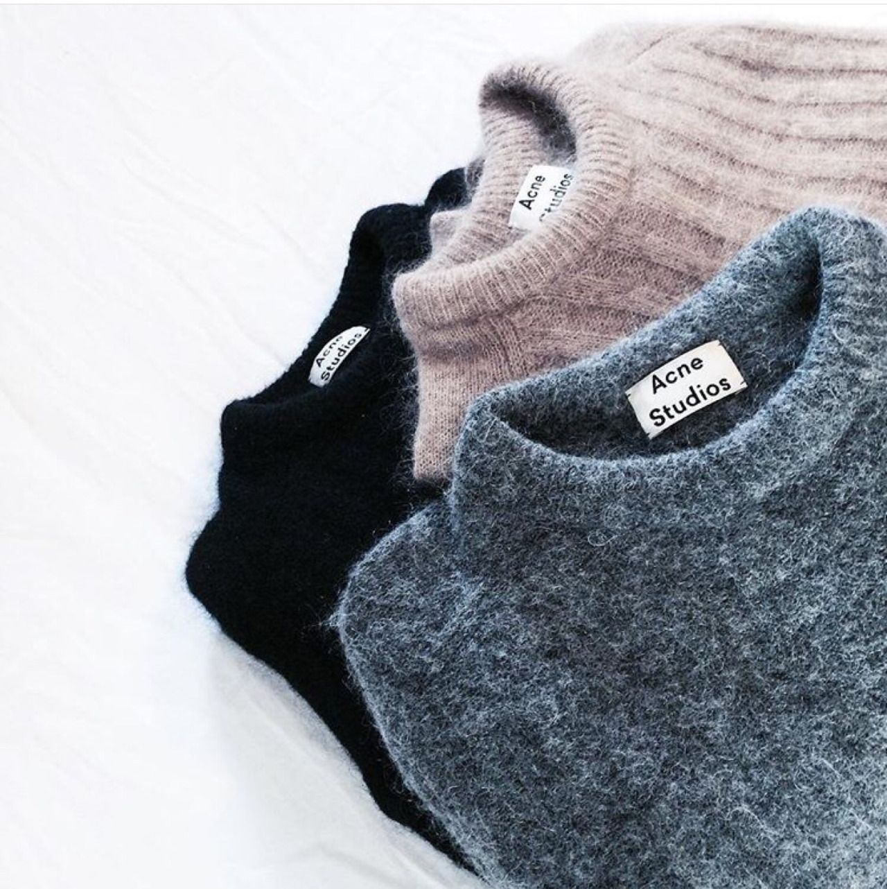 A pretty stack of Acne sweaters.