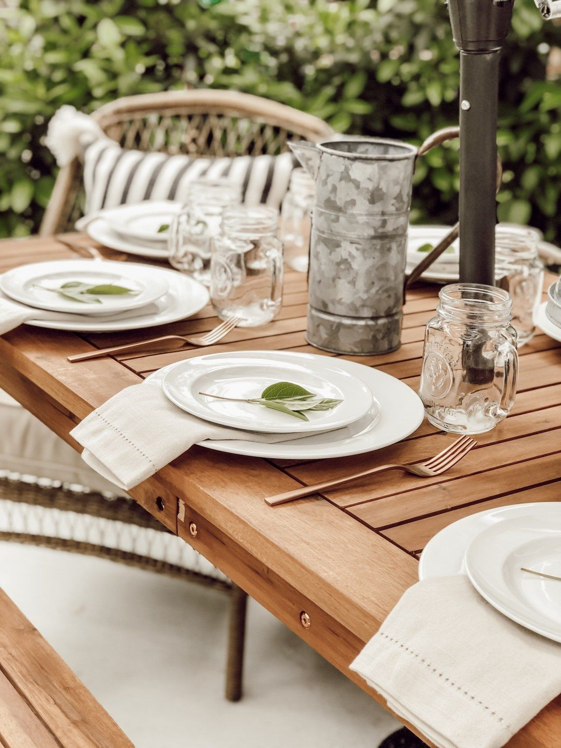 A neutral cottage style country farmhouse tablescape wood