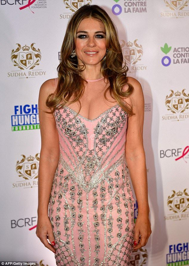 Elizabeth Hurley, 52, dazzles in pink gown at charity dinner in Paris