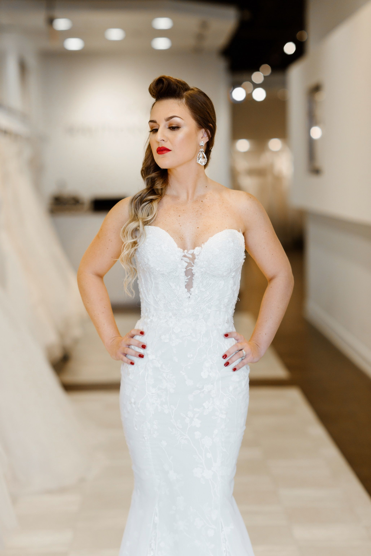 Plunging neckline, lace wedding dress by Marisa Bridal