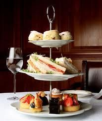 Afternoon Tea food placement for a three-tier curate stand:  Top: Scones (in the past, so a warming dome could cover them)  Middle: Savories & Sandwiches  Bottom: Sweets