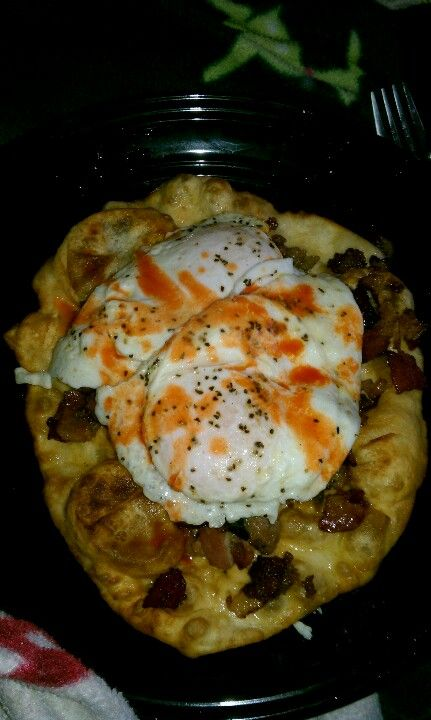 navajo fry bread topped with sausage and bacon hash with onion and jalapenos, over easy eggs