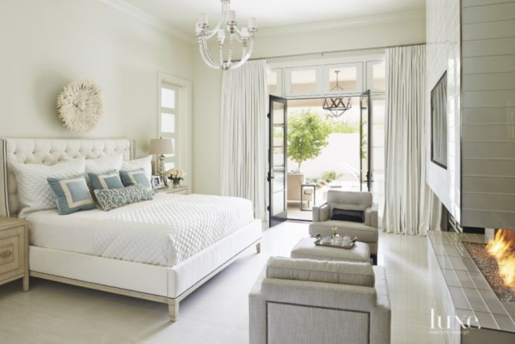 Mediterranean Neutral Bedroom With Feather Headdress