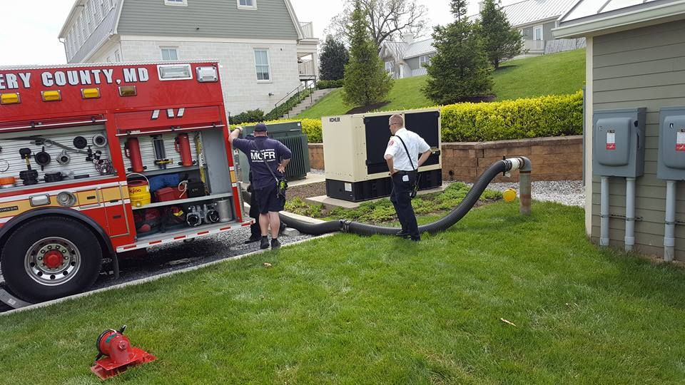 a picture of Engine 717 from Laytonsville testing a cistern in their area