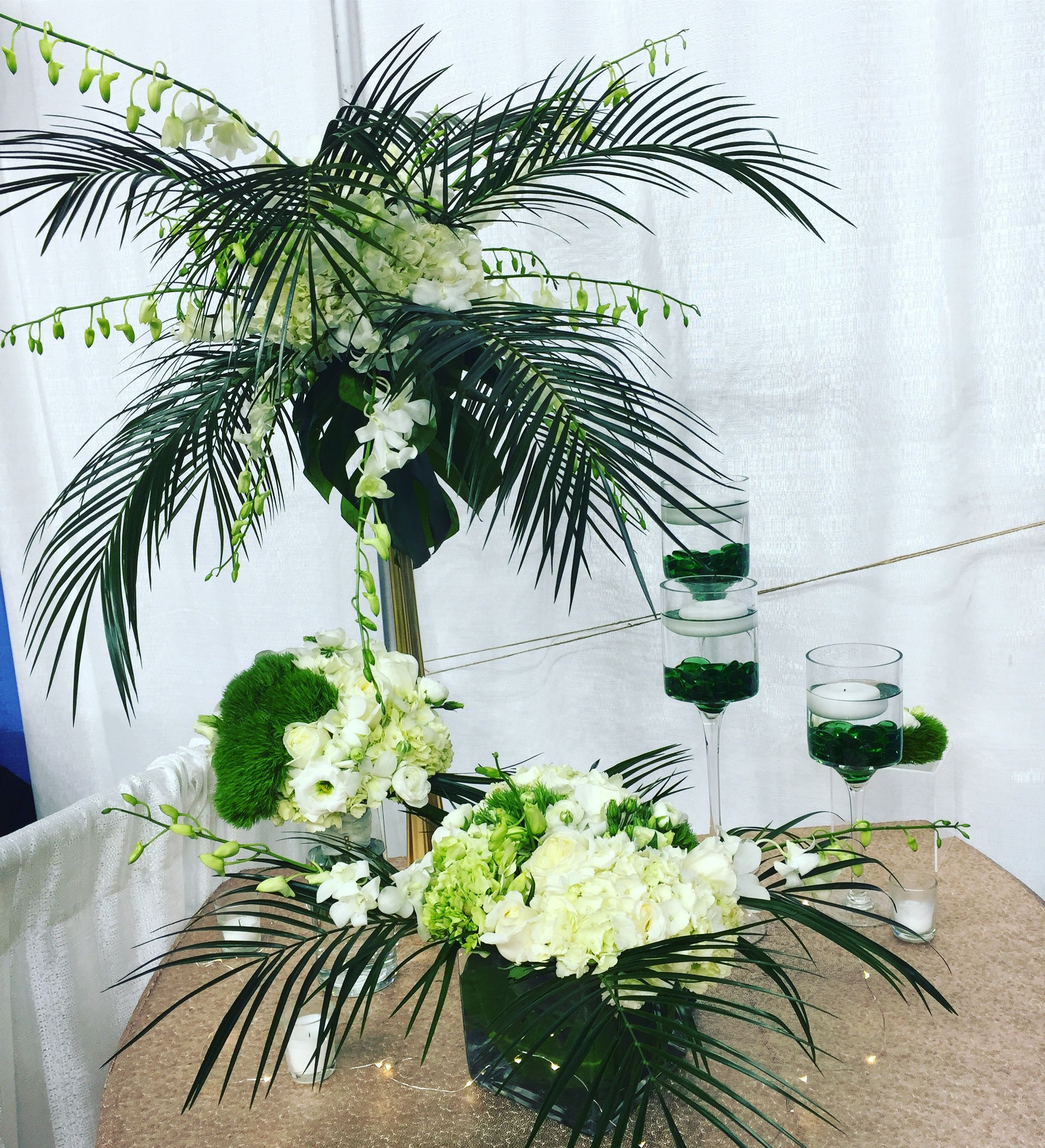 Centerpieces By Flowers Of The Forest Eiffel Tower Vase Gold With Palm Leaves Amp Orchids Low