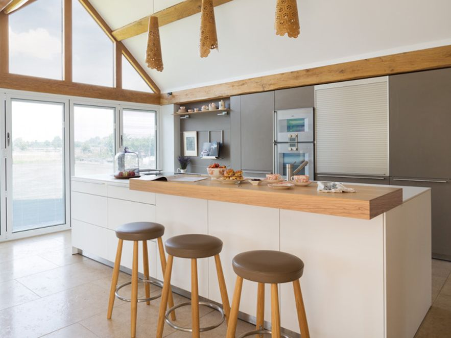 Baulthup Through Kitchen Architecture   Overhang Bar, Dark Against Wall And  Lighter Island