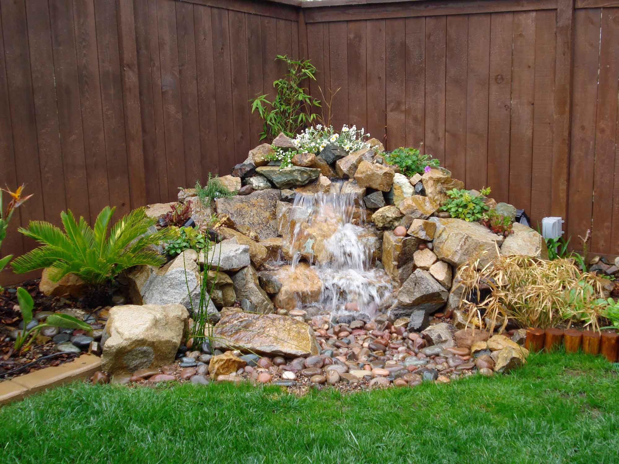Natural small pondless waterfalls advanced waterscape projects big and small outside - Corner pond ideas ...