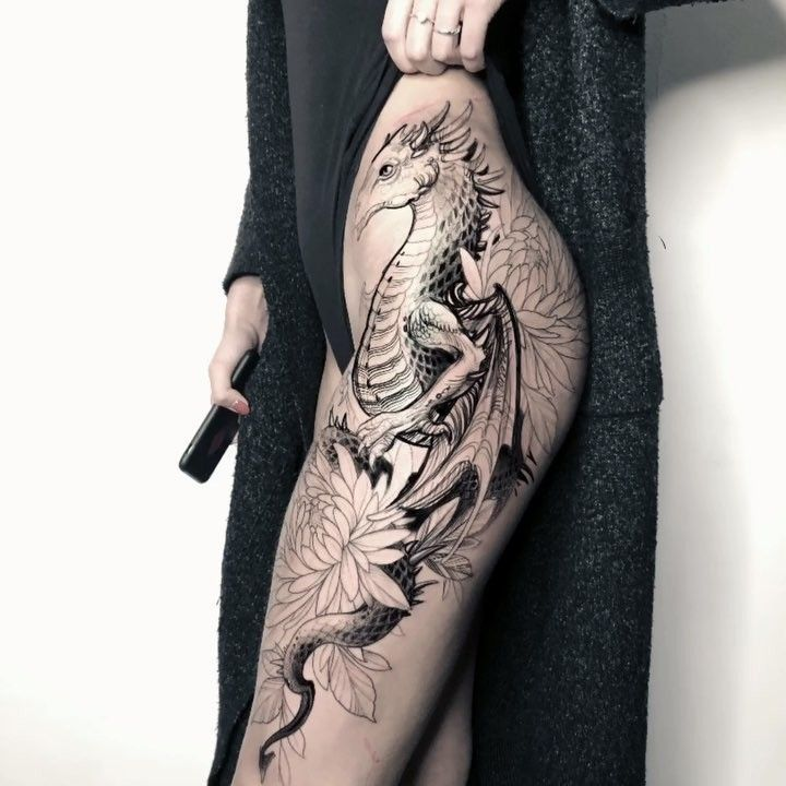 Photo of Dragon hip tattoo