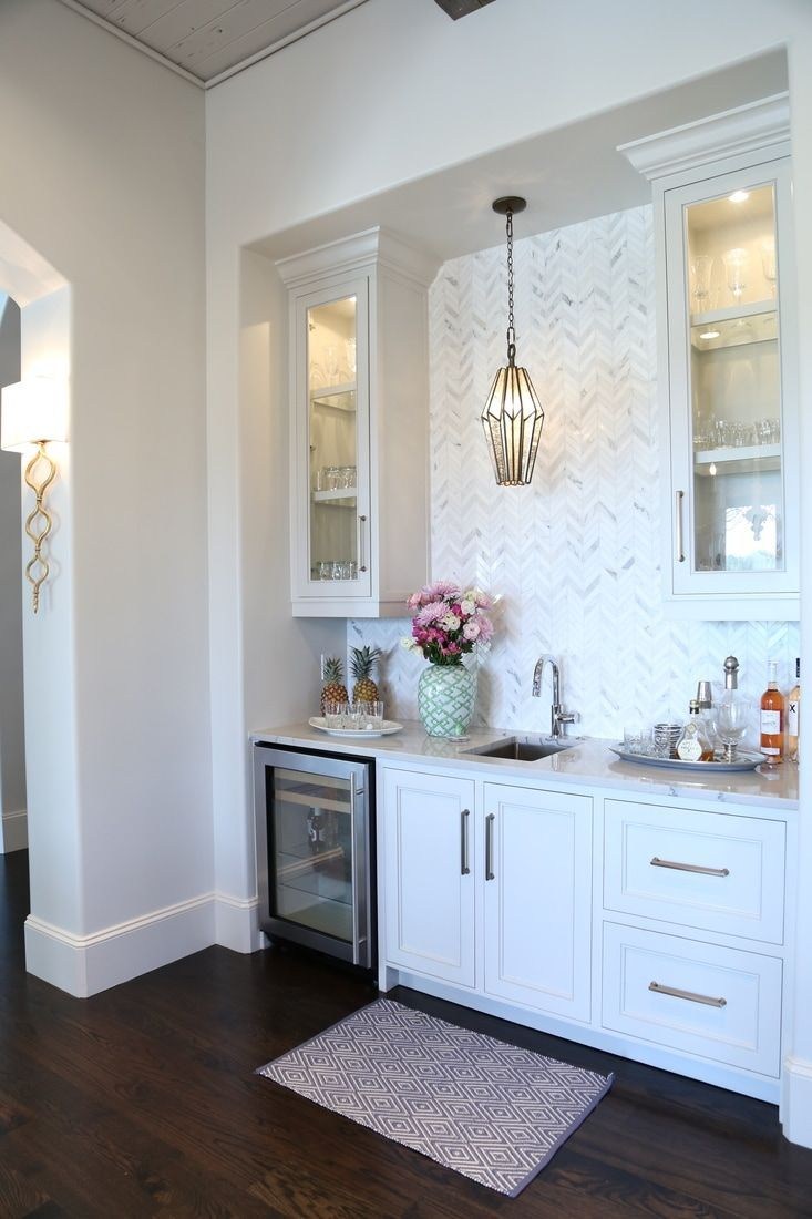 Side bar with white backsplash white cabinets and pink accents