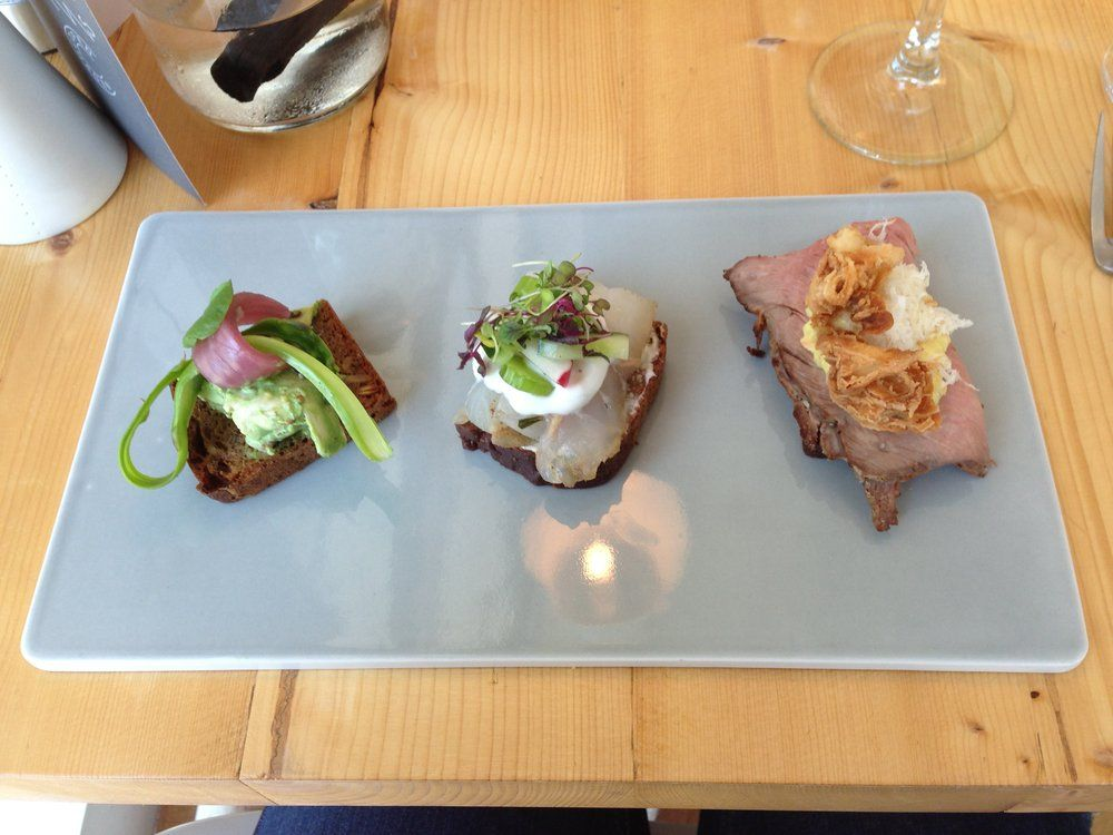 Aamanns-Copenhagen in NY: Lunch prix-fixe course #2: Three half-smørrebrød (chicken salad (left), cured hake (center) + roast beef (right) | Yelp