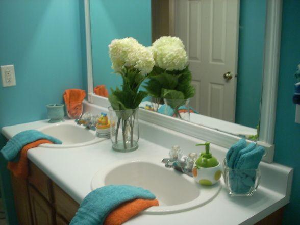 This Is The Color In My Kids Bath Room It Is Very Cool For A Bath That Has No Windows We Hav Teal Bathroom Decor Brown Bathroom Decor Orange Bathroom Decor