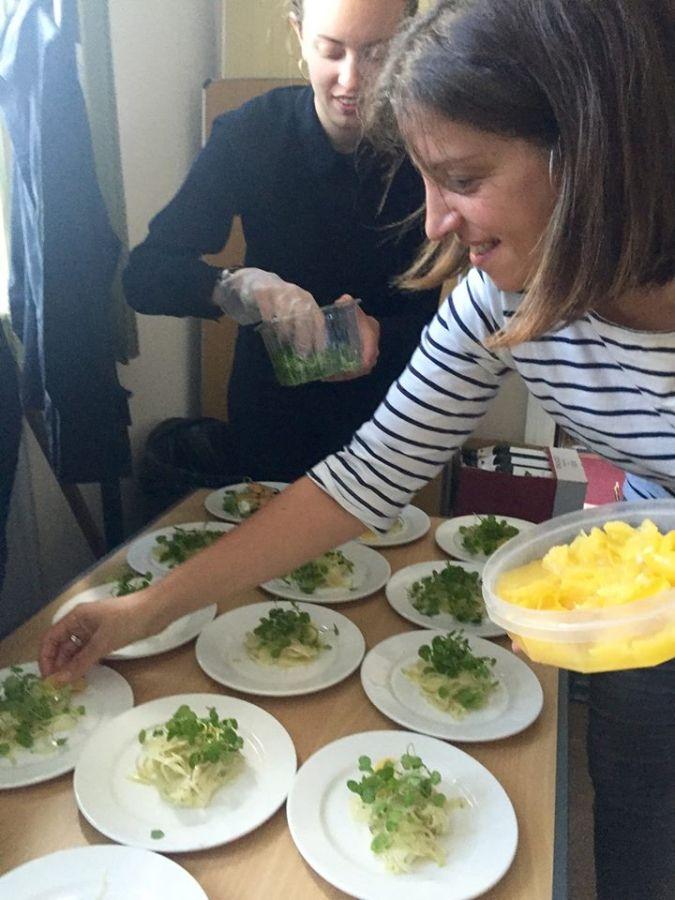 Prepping The Harissa Prawns Served With Tzatzikifennel Grape