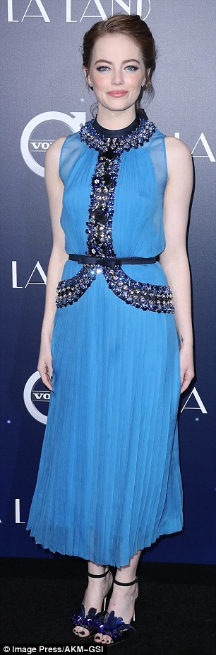 Stunner: The 28-year-old actress looked typically elegant in a blue sleeveless number while joined by her co-stars at the Westwood Village Theatre