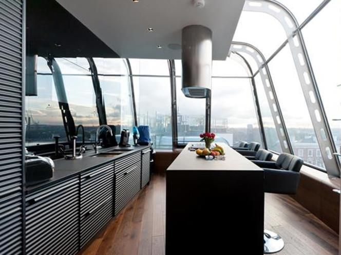 Another good example of a hyper modern kitchen with centralised work ...