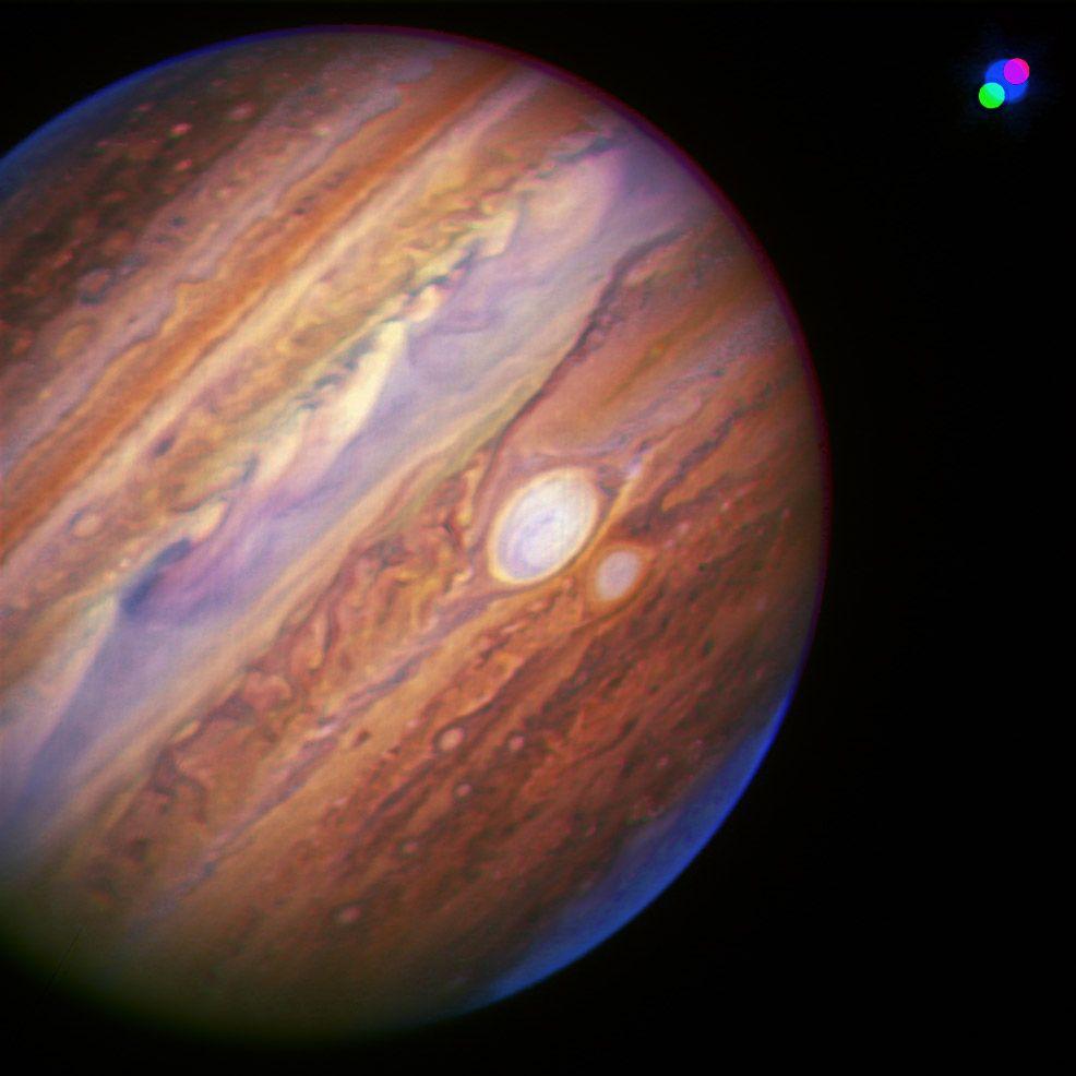 Jupiter 2006  Imke de Pater, Michael Wong (UC Berkeley); Al Conrad (Keck Observatory), and Chris Go (Cebu, RP)  A false-color composite near-infrared image of Jupiter and its moon Io, taken July 20 Hawaii time (July 21 UT) by the Keck II telescope on Mauna Kea using adaptive optics (AO) to sharpen the image.