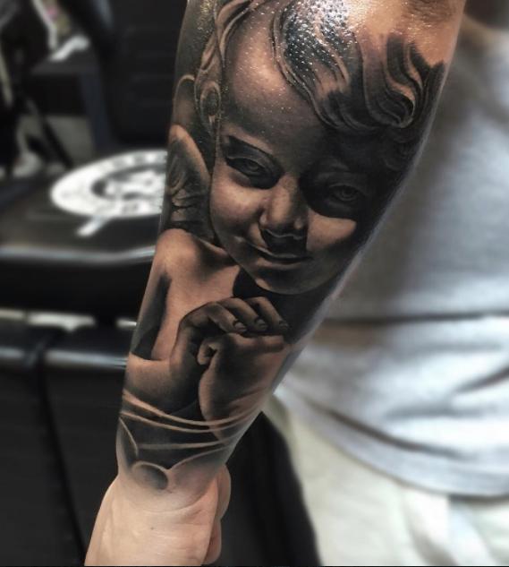 Cherub Angel Tattoo Inkstylemag Cherub Tattoo Cherub Tattoo Designs Sleeve Tattoos