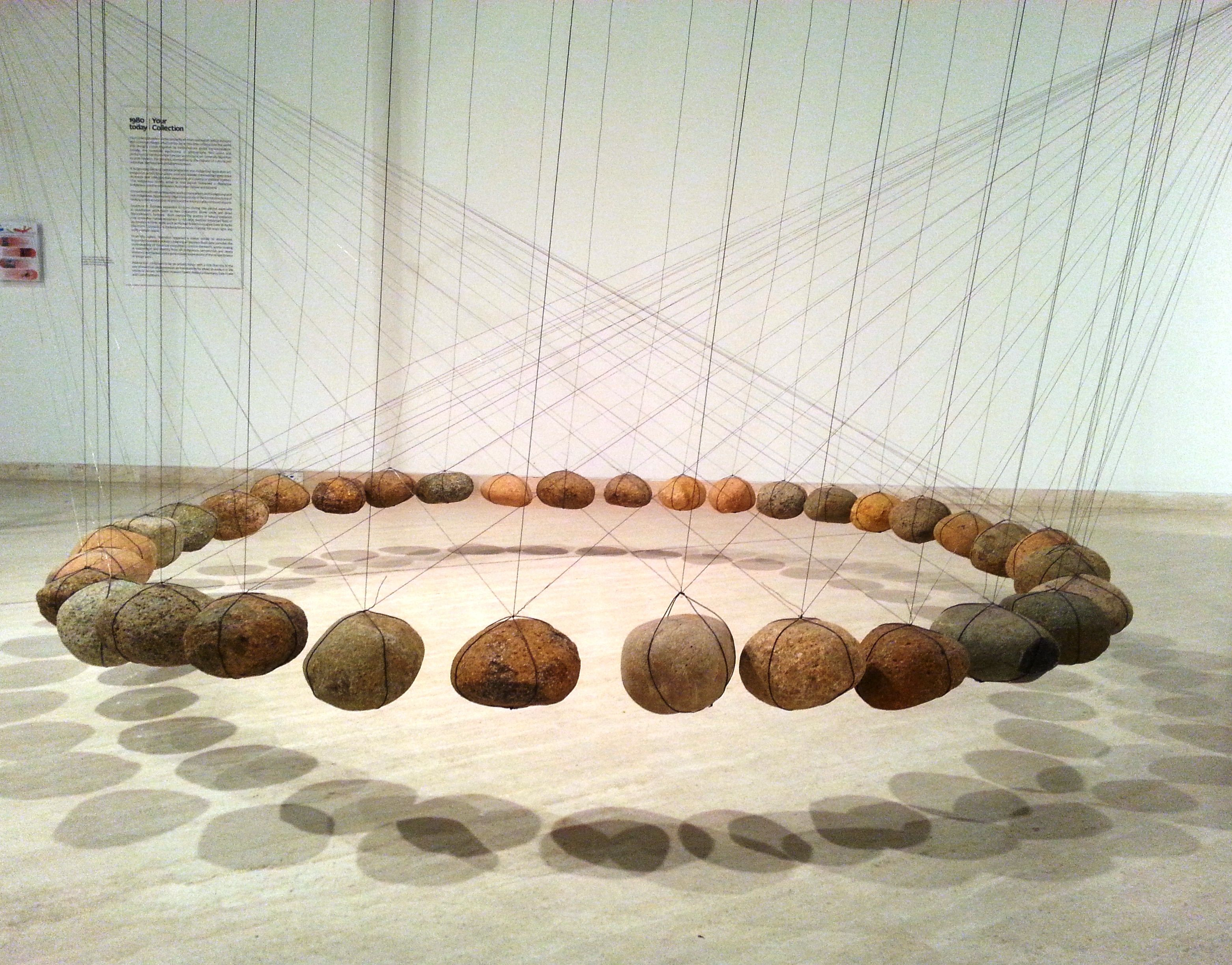 Image of Ken Unsworth\'s installation featuring stones suspended by ...