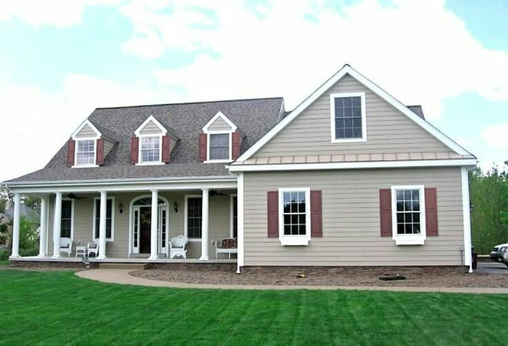 Ranch With Tan Siding And Maroon Shutters Exterior