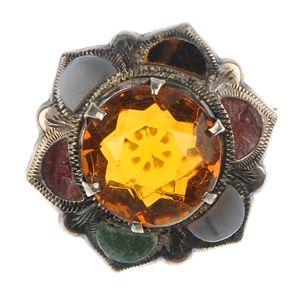LOT:320 | A selection of three early 20th century gem-set brooches...yellow pas ste centre