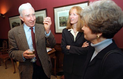ulitzer Prize-winning author John Updike talks with Laura Skandera Trombley (center), dean of faculty at Coe College, and Linnie Phifer, wife of Coe President James Phifer, before a lecture at Sinclair Auditorium at Coe College, April 5, 2001. Updike read a selection of poems and prose he had written about the college experience in commemoration of Coe Colleges 150th birthday.