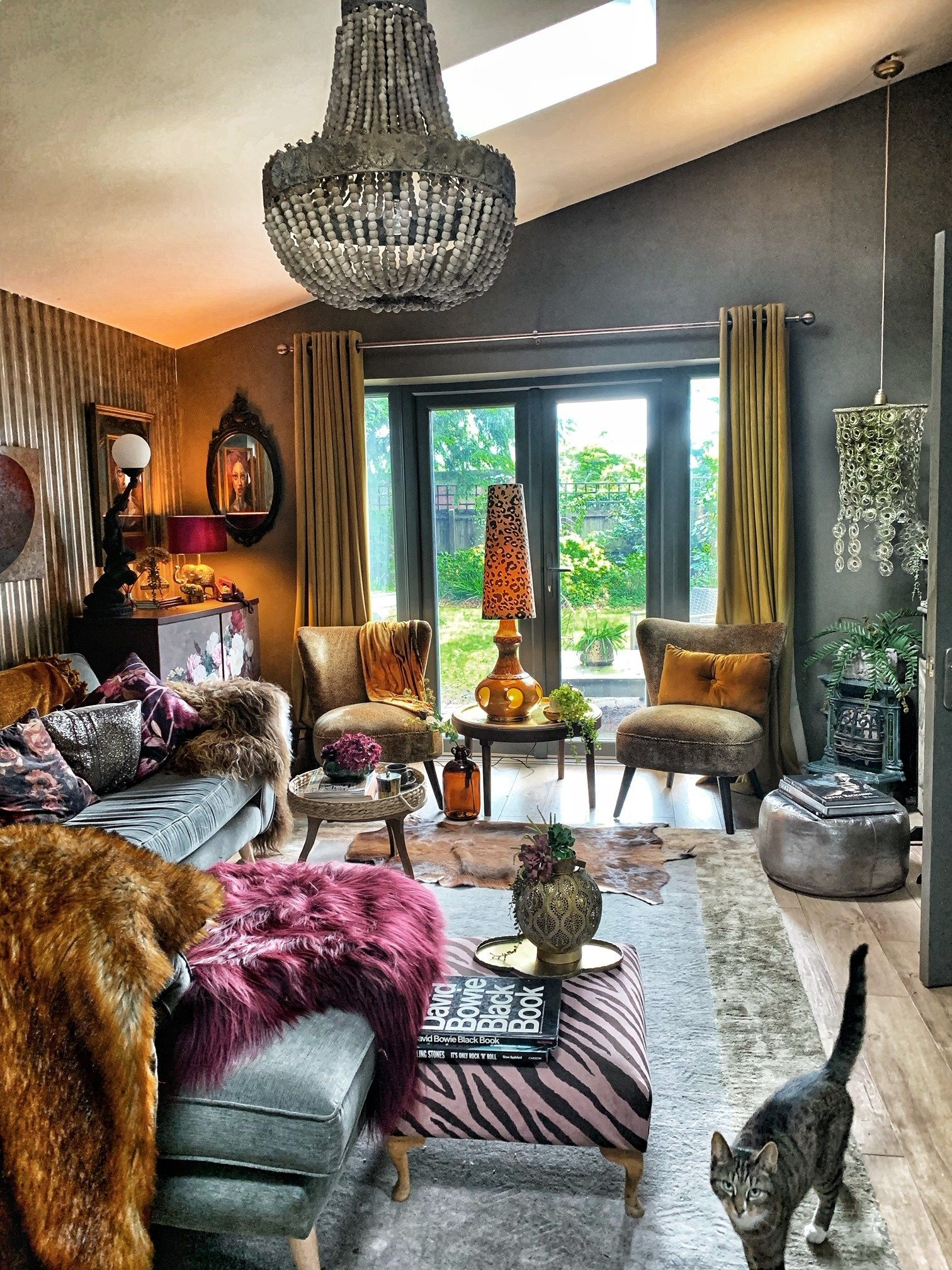 The Unique & Glamorous Maximalist Home of Sarah Parmenter Upcyclist Extraordinaire​ | Here, Sarah has combined her love of animal print with softer florals. Whilst you might not think this combination would work, they do by the clever use of colour. #livingroom #eclecticdecor #maximalistinteriors #maximalistdecor #interiorinspo #interiordesign #interiordecor #homedecor #housetour #interiors #homedesign