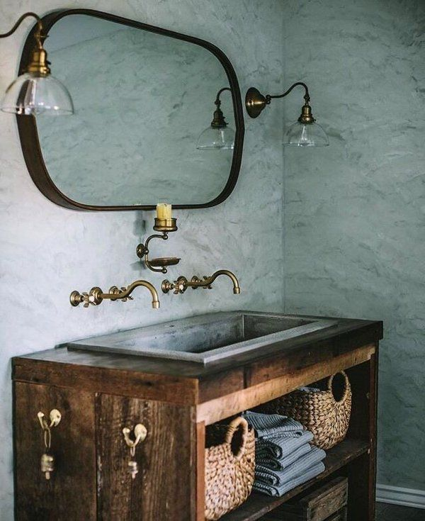 Two Fords Mill Single Sconces bring a utilitarian, yet stylish touch to @evakosmasflores' bathroom.  This sconce is a classic swing-arm wall bracket with a turnkey socket that can be adjusted side to side without tools—just gently push it where you want the light to be.    We love Eva's choice of a cool, Sea Salt-color for the walls paired with all brass fixtures and the dark wood of the vanity, made by her husband @jeremyflores.  #RejuveSpotted #wallsconce #bathroom #bathroomlighting