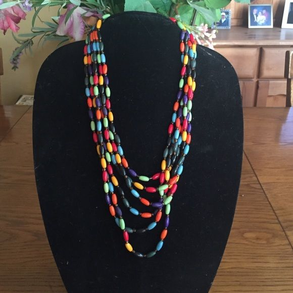 Multi colored beaded necklace. Six strand multi colored layers necklace. Goes with everything. Great accent piece Jewelry Necklaces