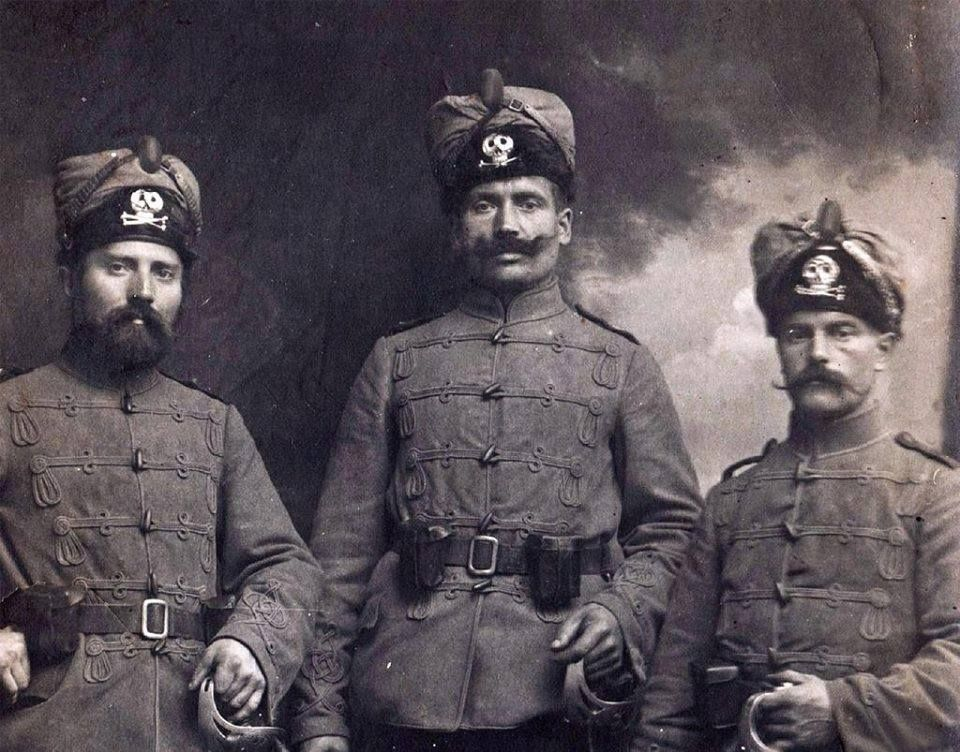 http://bearenhunger.tumblr.com/post/130826680456/three-german-men-wearing-the-uniform-of-the-deaths Three German men wearing the uniform of the Deaths Head or totenkopf badged Hussars.Dated to First World War or just prior.The hats worn here I have found mention of them to be called a peltmuze.