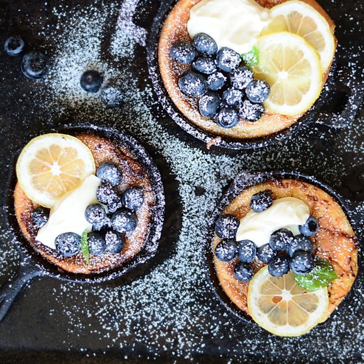 10 Adorable Mini CastIron Skillet Recipes  Mini Dutch Baby pancakes with fresh blueberries and Mascarpone Cream