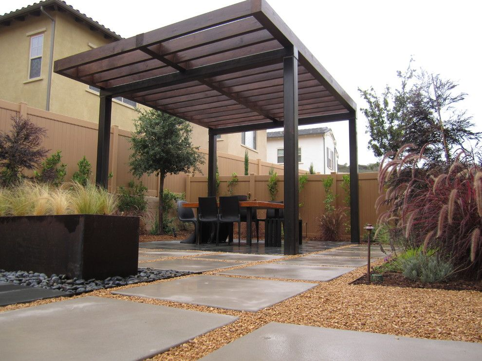 Outdoor Dining Area With Pergola With Steel Posts And Open