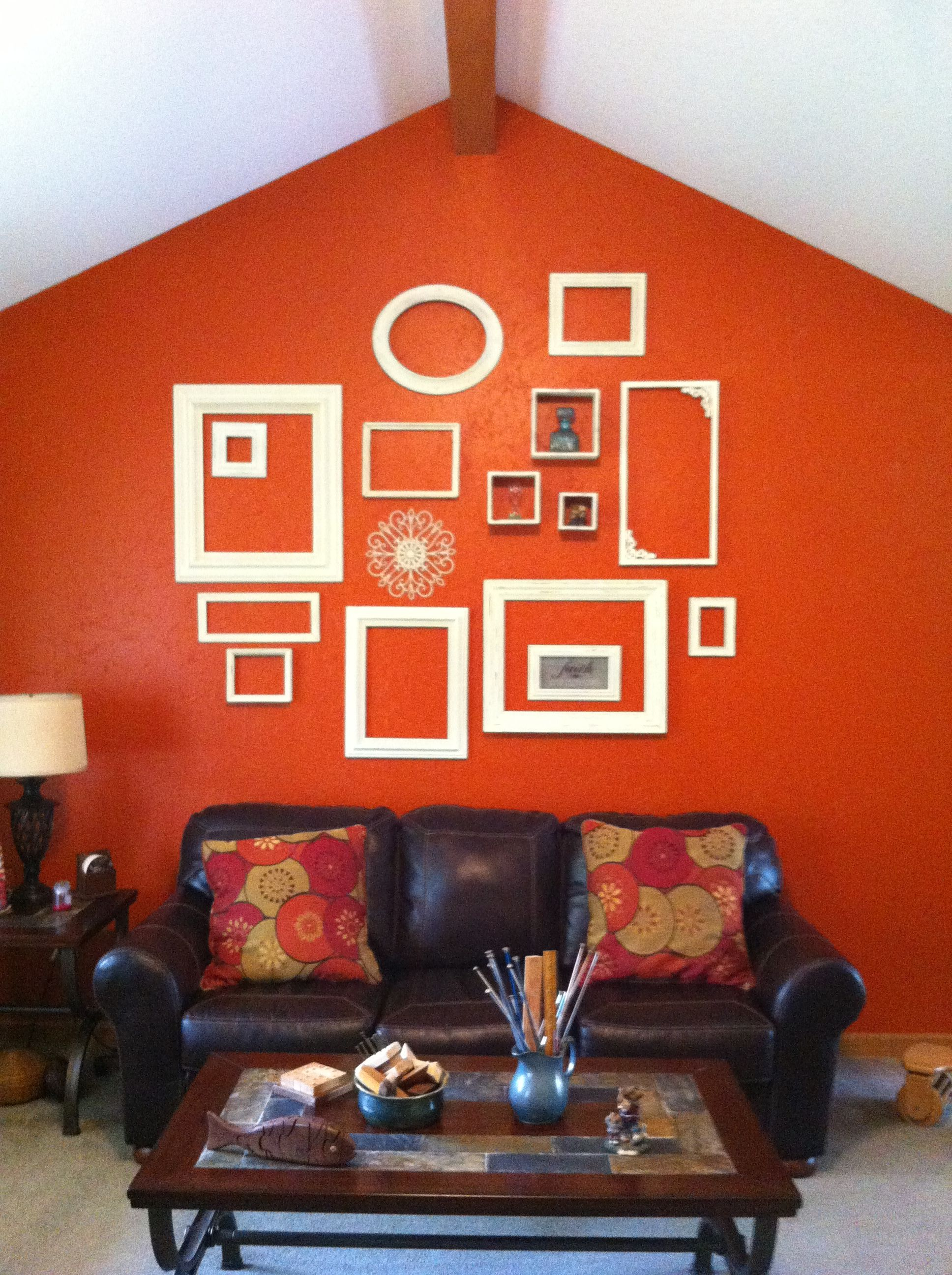 My Living Room Wall Inspired By Pinterest Burnt Orange Wall With Empty Frames Painted Ivory And Then D Living Room Paint Living Room Colors Room Paint Colors