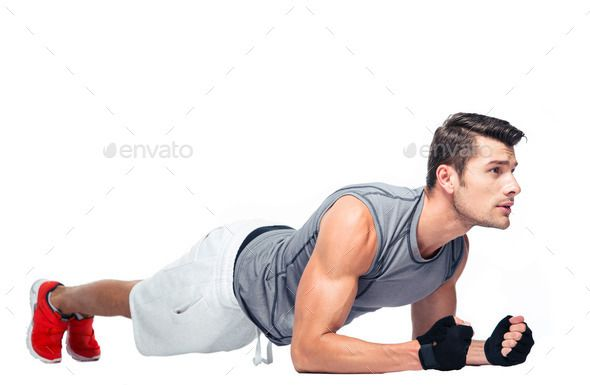 Fitness man doing exercises on the floor by vadymvdrobot. Fitness man doing exercises on the floor f...