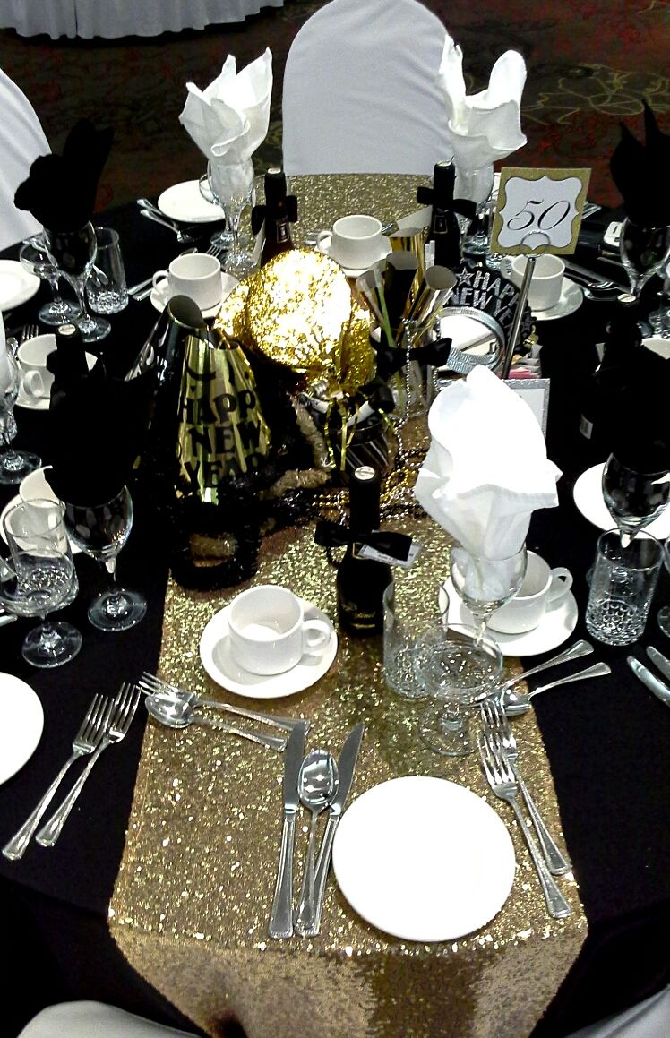 Black gold and silver centerpiece for a tie affair