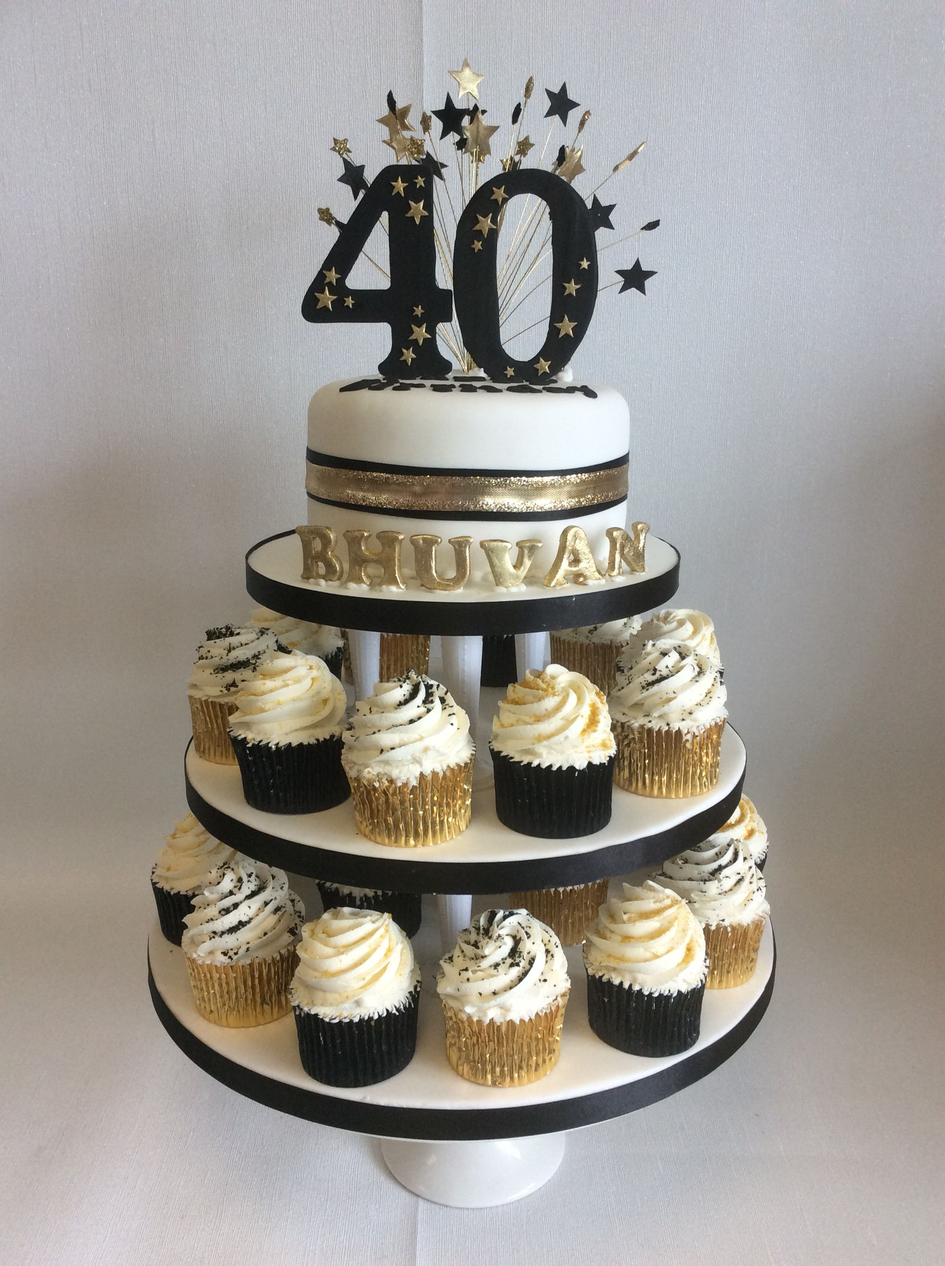 Small Display Of Black Gold Themed Cup Cakes With Top Tier For