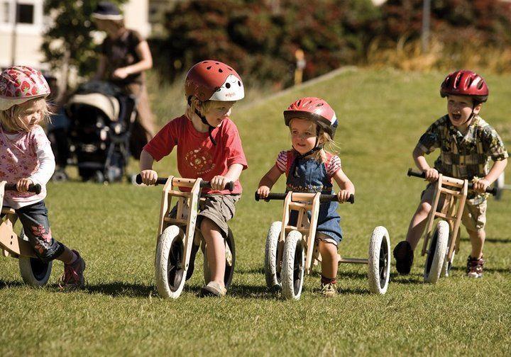 A Group Of Kids Enjoying Their Wishbone Bikes In Various