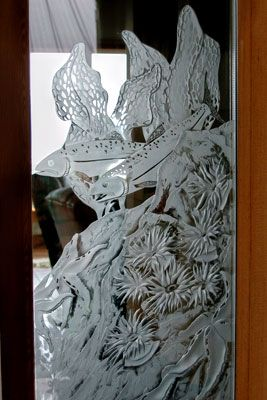 Deep carved etched window