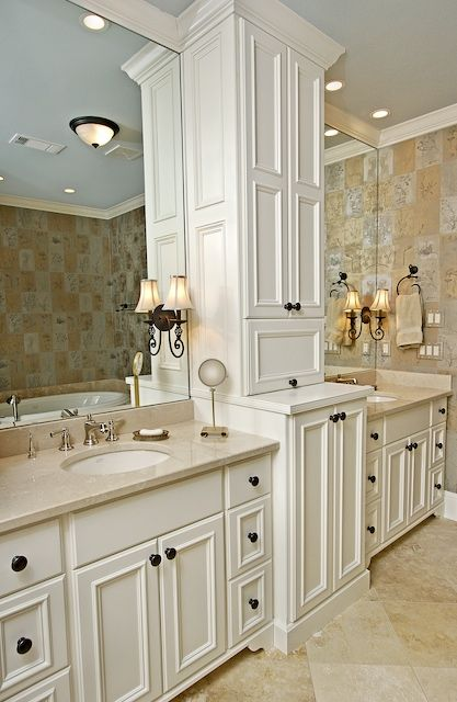 Photo of Vanities for him and her with shared central storage space for bathing equipment. Photo of …