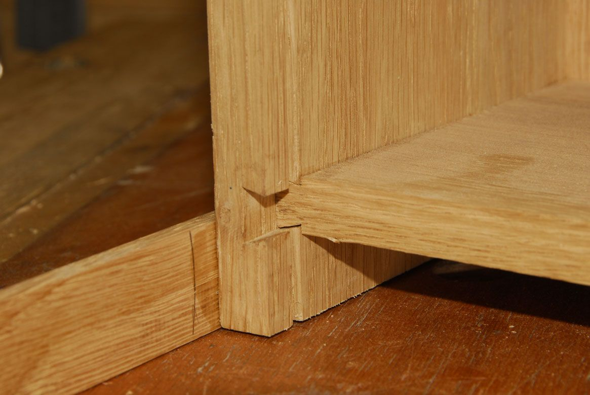 The Sliding Dovetail Joint Holding The Bottom Of A Cabinet
