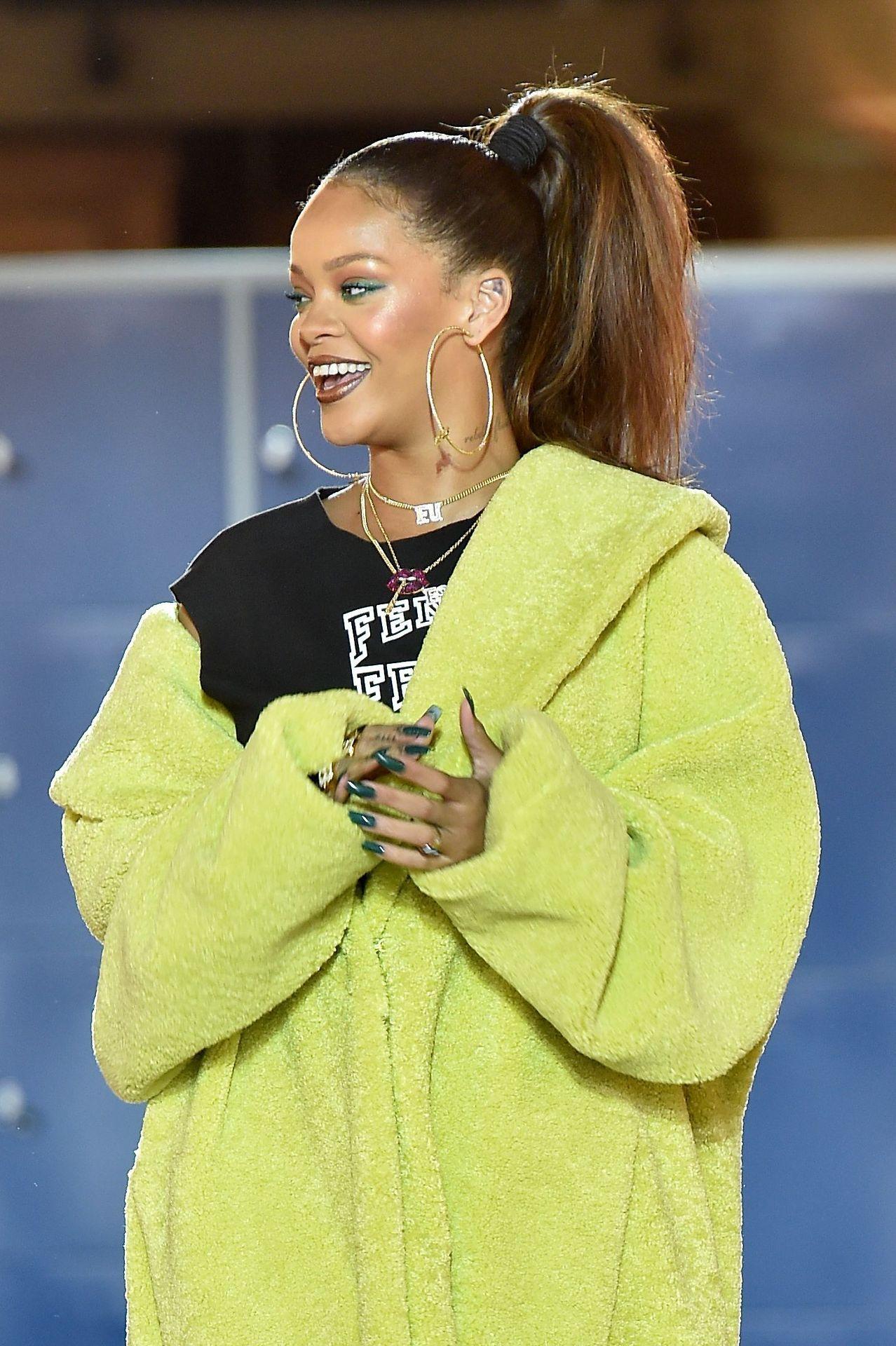 Yellow dress rihanna  Rihanna walks the runway at the Fenty x Puma by Rihanna show as part